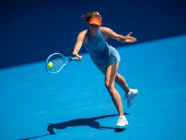 """MELBOURNE, AUSTRALIA - JANUARY 20:  Maria Sharapova of Russia hits a forehand to Ashleigh Barty of Australia during day seven of the 2019 Australian Open at Melbourne Park on January 20, 2019 in Melbourne, Australia. (Photo by TPN/Getty Images)""""n""""n""""n""""n"""