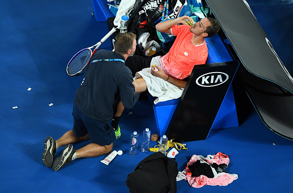 MELBOURNE, AUSTRALIA - JANUARY 21: Daniil Medvedev of Russia receives treatment in his fourth round match against Novak Djokovic of Serbia during day eight of the 2019 Australian Open at Melbourne Park on January 21, 2019 in Melbourne, Australia. (Photo by Quinn Rooney/Getty Images)