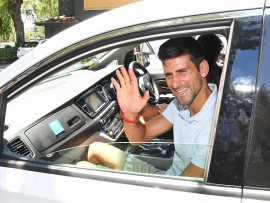 MELBOURNE, AUSTRALIA - JANUARY 28: Novak Djokovic of Serbia arriving by car to the trophy presentation where he will receive the Norman Brookes Challenge Cup after winning the 2019 Australian Open at Picnic Point, Royal Botanical Gardens on January 28, 2019 in Melbourne, Australia. (Photo by James D. Morgan/Getty Images)