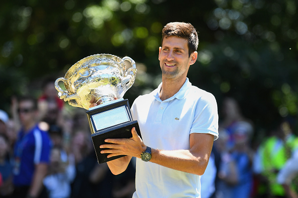MELBOURNE, AUSTRALIA - JANUARY 28: Novak Djokovic of Serbia poses with the Norman Brookes Challenge Cup after winning the 2019 Australian Open at Picnic Point, Royal Botanical Gardens on January 28, 2019 in Melbourne, Australia. (Photo by James D. Morgan/Getty Images)