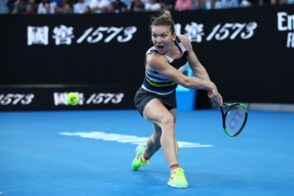 MELBOURNE, AUSTRALIA - JANUARY 21: Simona Halep of Romania plays a backhand in her fourth round match against Serena Williams of the United States during day eight of the 2019 Australian Open at Melbourne Park on January 21, 2019 in Melbourne, Australia. (Photo by Cameron Spencer/Getty Images)