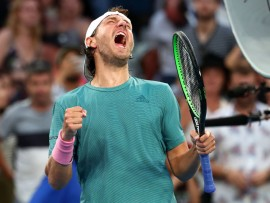 MELBOURNE, AUSTRALIA - JANUARY 21:  Lucas Pouille of France celebrates after winning match point in his fourth round match against Borna Coric of Croatia during day eight of the 2019 Australian Open at Melbourne Park on January 21, 2019 in Melbourne, Australia.  (Photo by Michael Dodge/Getty Images)