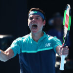 MELBOURNE, AUSTRALIA - JANUARY 21:  Milos Raonic of Canada celebrates after winning match point in his fourth round match against Alexander Zverev of Germany during day eight of the 2019 Australian Open at Melbourne Park on January 21, 2019 in Melbourne, Australia.  (Photo by Scott Barbour/Getty Images)