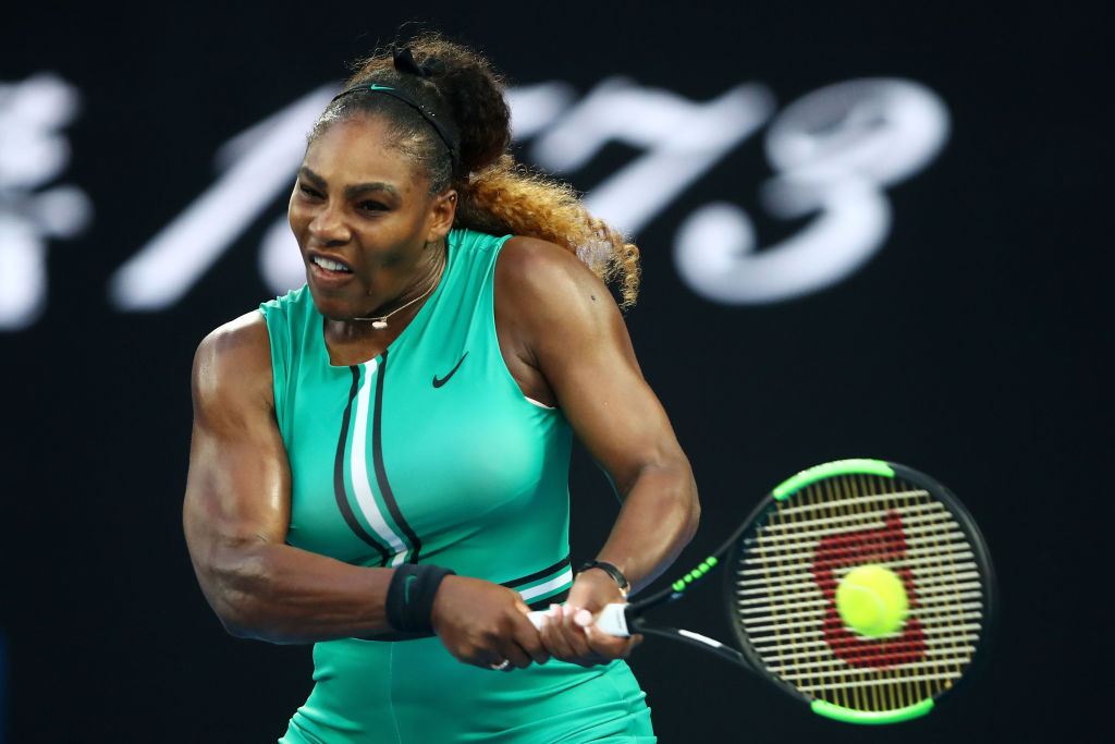 MELBOURNE, AUSTRALIA - JANUARY 21: Serena Williams of the United States plays a backhand in her fourth round match against Simona Halep of Romania during day eight of the 2019 Australian Open at Melbourne Park on January 21, 2019 in Melbourne, Australia. (Photo by Julian Finney/Getty Images)