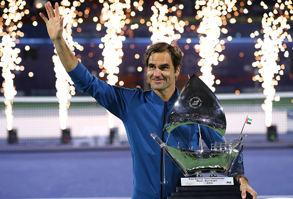 DUBAI, UNITED ARAB EMIRATES - MARCH 02: Rodger Federer of Switzerland poses with the winners trophy after victory during day fourteen of the Dubai Duty Free Championships at Tennis Stadium on March 02, 2019 in Dubai, United Arab Emirates. (Photo by Francois Nel/Getty Images)