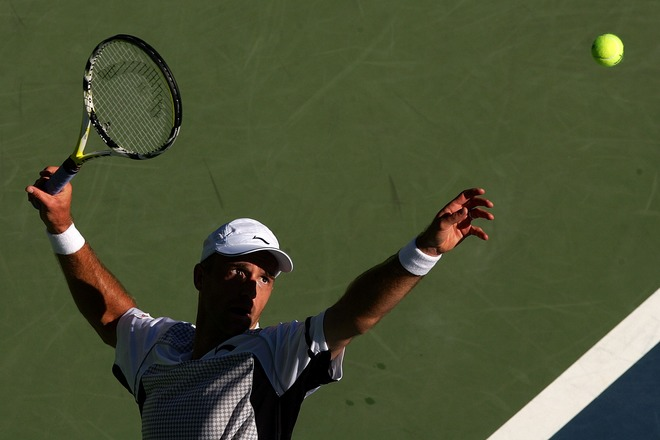 NEW YORK - SEPTEMBER 02: Ivan Ljubicic of Croatia serves against Juan Ignacio Chela of Argentina during day seven of the 2007 U.S. Open at the Billie Jean King National Tennis Center on September 2, 2007 in the Flushing neighborhood of the Queens borough of New York City. (Photo by Chris McGrath/Getty Images)