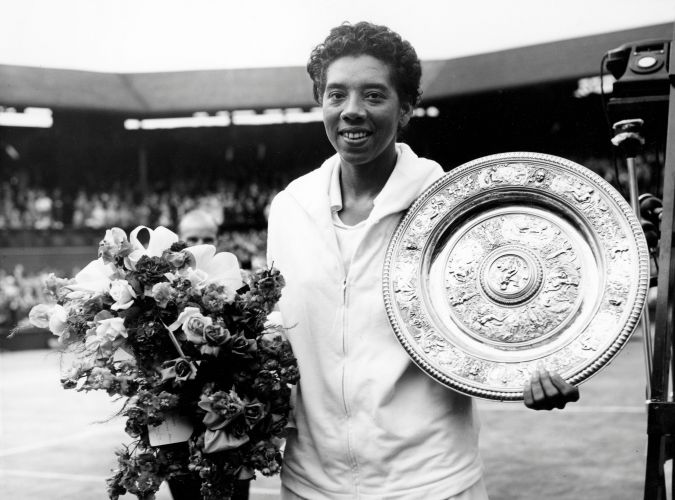 Picture taken on July 5, 1958 at Wimbledon showing American tennis player Althea Gibson after winning the Wimbledon lawn tennis championships. (Photo by - / INTERNATIONAL NEWS PHOTOS / AFP) / France ONLY (Photo credit should read -/AFP/Getty Images)