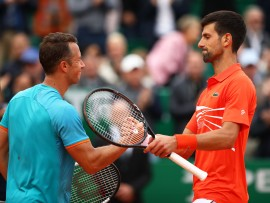 MONTE-CARLO, MONACO - APRIL 16: Novak Djokovic of Serbia shakes hands at the net after his three set victory against Philipp Kohlschreiber of Germany in their second round match during day 3 of the Rolex Monte-Carlo Masters at Monte-Carlo Country Club on April 16, 2019 in Monte-Carlo, Monaco. (Photo by Clive Brunskill/Getty Images)
