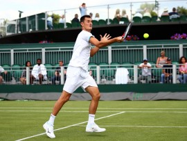 LONDON, ENGLAND - JULY 02: Bernard Tomic of Australia plays a forehand in his Men's Singles first round match against Jo-Wilfred Tsonga of France during Day two of The Championships - Wimbledon 2019 at All England Lawn Tennis and Croquet Club on July 02, 2019 in London, England. (Photo by Clive Brunskill/Getty Images)