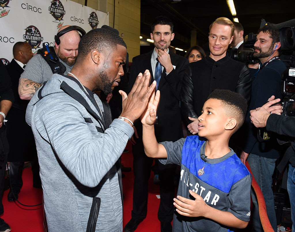 TORONTO, ON - FEBRUARY 12: Kevin Hart and Demarjay Smith attend the 2016 NBA All-Star Celebrity Game at Ricoh Coliseum on February 12, 2016 in Toronto, Canada. (Photo by George Pimentel/WireImage)