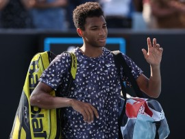 Canada's Felix Auger-Aliassime leaves the court after defeat against Latvia's Ernests Gulbis during their men's singles match on day two of the Australian Open tennis tournament in Melbourne on January 21, 2020. (Photo by DAVID GRAY / AFP) / IMAGE RESTRICTED TO EDITORIAL USE - STRICTLY NO COMMERCIAL USE (Photo by DAVID GRAY/AFP via Getty Images)