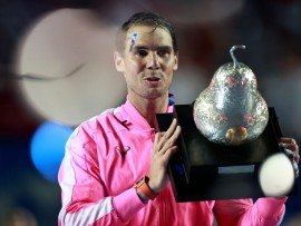 ACAPULCO, MEXICO - FEBRUARY 29: Rafael Nadal of Spain celebrates with the winner's trophy after defeating Taylor Fritz of the United States during Day 6 of the ATP Mexican Open at Princess Mundo Imperial on February 29, 2020 in Acapulco, Mexico. (Photo by Hector Vivas/Getty Images)