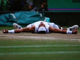 LONDON - JULY 06:  Rafael Nadal of Spain celebrates winning match point and the Championship during the men's singles Final match against Roger Federer of Switzerland on day thirteen of the Wimbledon Lawn Tennis Championships at the All England Lawn Tennis and Croquet Club on July 6, 2008 in London, England.  (Photo by Alessia Pierdomenico-Pool/Getty Images)