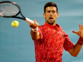 BELGRADE, SERBIA - JUNE 13: Novak Djokovic of Serbia returns the ball to Filip Krajinovic of Serbia during the Adria Tour charity exhibition hosted by Novak Djokovic on June 13, 2020 in Belgrade, Serbia. (Photo by Srdjan Stevanovic/Getty Images)