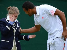 France's Jo-Wilfried Tsonga attends to a line judge who has been hit in the face by a ball during his fourth round men's singles match against US player Mardy Fish on day seven of the 2012 Wimbledon Championships tennis tournament at the All England Tennis Club in Wimbledon, southwest London, on July 2, 2012. AFP PHOTO / LEON NEAL    RESTRICTED TO EDITORIAL USELEON NEAL/AFP/GettyImages