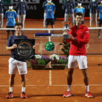 ROME, ITALY - SEPTEMBER 21: Runner-up Diego Schwartzman of Argentina (L) and winner Novak Djokovic of Serbia (R) pose with their respective trophies after their men's final match during day eight of the Internazionali BNL d'Italia at Foro Italico on September 21, 2020 in Rome, Italy. (Photo by Clive Brunskill/Getty Images)