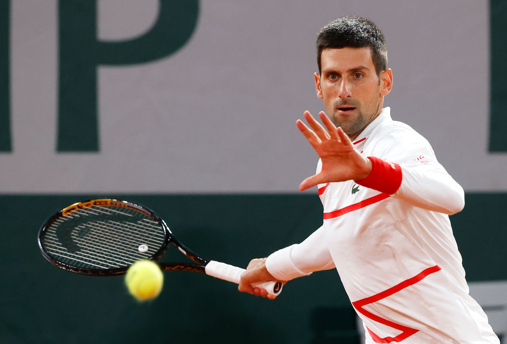 PARIS, FRANCE - SEPTEMBER 29: Novak Djokovic of Serbia plays a forehand during his Men's Singles first round match against Mikael Ymer of Sweden on day three of the 2020 French Open at Roland Garros on September 29, 2020 in Paris, France. (Photo by Clive Brunskill/Getty Images)