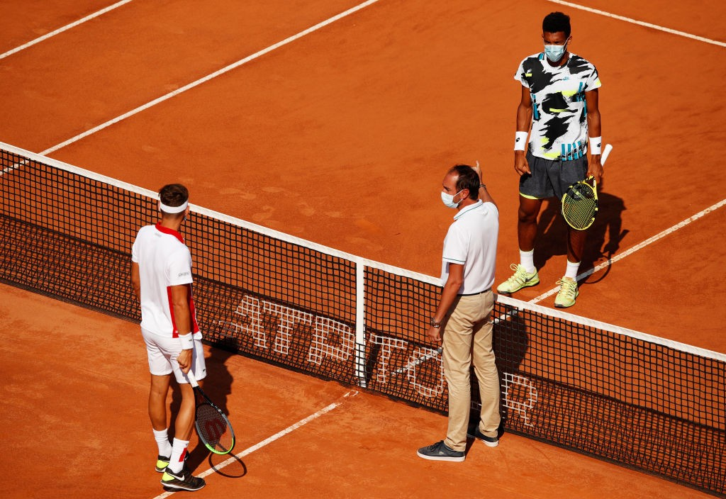 ROME, ITALY - SEPTEMBER 14: Felix Auger-Aliassime of Canada and Filip Krajinovic of Serbia take part in the coins toss ahead of their round one match during day one of the Internazionali BNL D'Italia at Foro Italico on September 14, 2020 in Rome, Italy. (Photo by Clive Brunskill/Getty Images)