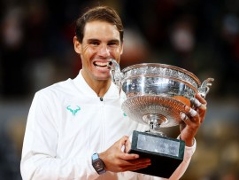 PARIS, FRANCE - OCTOBER 11: Rafael Nadal of Spain bites the winners trophy following victory in his Men's Singles Final against Novak Djokovic of Serbia on day fifteen of the 2020 French Open at Roland Garros on October 11, 2020 in Paris, France. (Photo by Julian Finney/Getty Images)