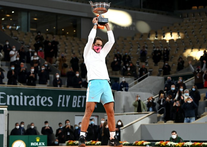 PARIS, FRANCE - OCTOBER 11: Rafael Nadal of Spain lifts the winners trophy following victory in his Men's Singles Final against Novak Djokovic of Serbia on day fifteen of the 2020 French Open at Roland Garros on October 11, 2020 in Paris, France. (Photo by Shaun Botterill/Getty Images)