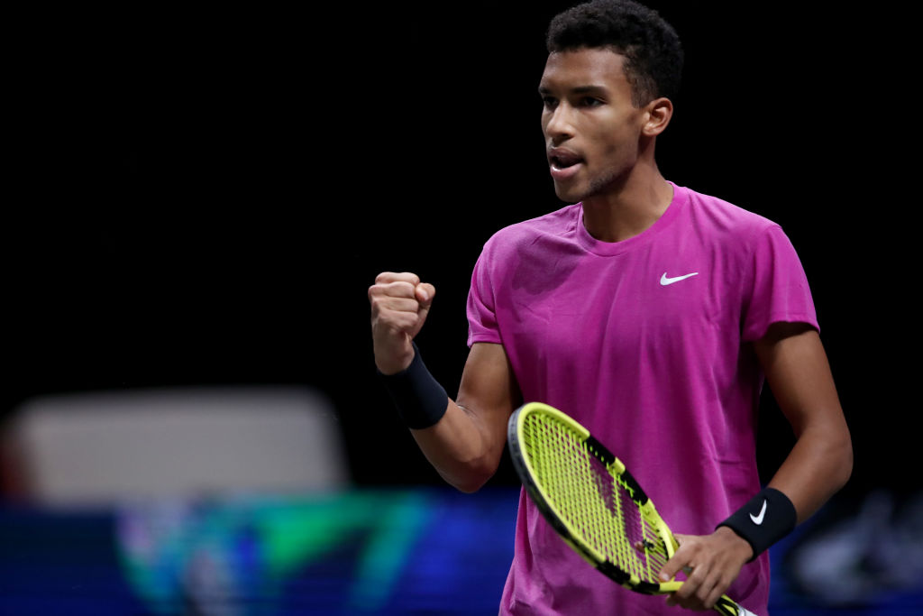COLOGNE, GERMANY - OCTOBER 24: Felix Auger-Aliassime of Canada celebrates during the semi final match between Felix Auger-Aliassime of Canada and Diego Schwartzman of Argentina of day six of the Bett1Hulks Championship Tennis Tournament at Lanxess Arena on October 24, 2020 in Cologne, Germany. (Photo by Christof Koepsel/Getty Images)
