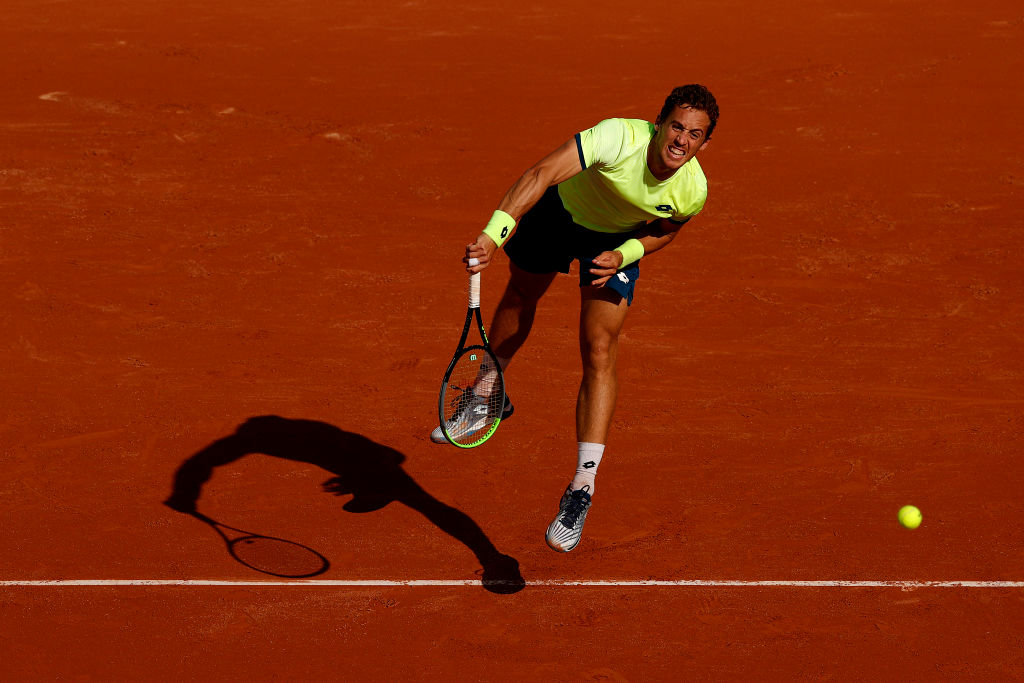 PARIS, FRANCE - OCTOBER 01: Roberto Carballes Baena of Spain serves during his Men's Singles second round match against Denis Shapovalov of Canada on day five of the 2020 French Open at Roland Garros on October 01, 2020 in Paris, France. (Photo by Clive Brunskill/Getty Images)