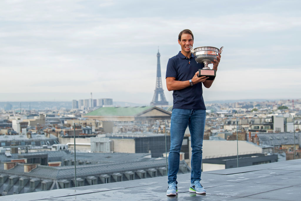 PARIS, FRANCE - OCTOBER 12: Rafael Nadal of Spain poses on the roof of Les Galeries Lafayette with Les Mousquetaires trophy following his victory in the Men's Singles Finals against Novak Djokovic of Serbia on day fifteen of the 2020 French Open on October 12, 2020 in Paris, France. Rafael Nadal won his 13th trophy.  (Photo by Aurelien Meunier/Getty Images)