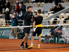 PARIS, FRANCE - OCTOBER 06: Diego Schwartzman of Argentina (R) embraces Dominic Thiem of Austria at the net following victory in their Men's Singles quarterfinals match on day ten of the 2020 French Open at Roland Garros on October 06, 2020 in Paris, France. (Photo by Clive Brunskill/Getty Images)