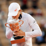 PARIS, FRANCE - OCTOBER 10: Iga Swiatek of Poland kisses the Suzanne-Lenglen cup following victory in her Women's Singles Final against Sofia Kenin of The United States of America on day fourteen of the 2020 French Open at Roland Garros on October 10, 2020 in Paris, France. (Photo by Clive Brunskill/Getty Images)