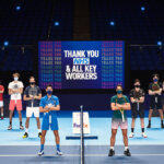 LONDON, ENGLAND - NOVEMBER 13: In this handout picture provided by ATP 2020 Nitto ATP Finals singles qualifiers from left to right: (L-R) Diego Schwartzman of Argentina, Alexander Zverev of Germany, Daniil Medvedev of Russia, Novak Djokovic of Serbia, Rafael Nadal of Spain, Dominic Thiem of Austria, Stefanos Tsitsipas of Greece and Andrey Rublev of Russia pose for a photo in front of a message saying 'Thank You NHS and All Key Workers' at The O2 Arena during previews for the Nitto ATP Finals at The O2 Arena on November 13, 2020 in London, England. (Photo by Wonderhatch/ATP via Getty Images)