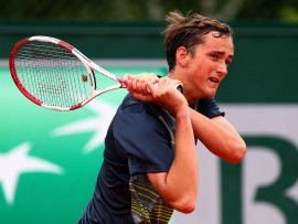 PARIS, FRANCE - JUNE 01:  Daniil Medvedev of Russia returns a shot during his boys' singles match against Pedro Martinez Portero of Spain on day eight of the French Open at Roland Garros on June 1, 2014 in Paris, France.  (Photo by Dan Istitene/Getty Images)