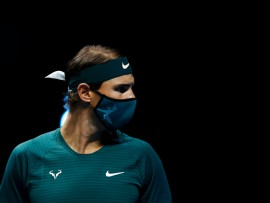 LONDON, ENGLAND - NOVEMBER 15: Rafael Nadal of Spain looks on while wearing a face mask ahead of his round robin match against Andrey Rublev of Russia during their first round robin match on Day one of the Nitto ATP World Tour Finals at The O2 Arena on November 15, 2020 in London, England. (Photo by Clive Brunskill/Getty Images)