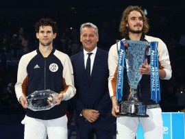 LONDON, ENGLAND - NOVEMBER 17:   Stefanos Tsitsipas of Greece with the winners trophy after his singles final match victory against Dominic Thiem of Austria along side ATP CEO Chris Kermode during Day Eight of the Nitto ATP Finals at The O2 Arena on November 17, 2019 in London, England. (Photo by Julian Finney/Getty Images)