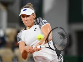 PARIS, FRANCE - OCTOBER 02: Elise Mertens of Belgium plays a backhand during her Women's Singles third round match against Caroline Garcia of France on day six of the 2020 French Open at Roland Garros on October 02, 2020 in Paris, France. (Photo by Shaun Botterill/Getty Images)