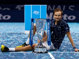 LONDON, ENGLAND - NOVEMBER 22:  Daniil Medvedev of Russia poses with the trophy after winning his singles final match against Dominic Thiem of Austria during day eight of the Nitto ATP World Tour Finals at The O2 Arena on November 22, 2020 in London, England. (Photo by Clive Brunskill/Getty Images)