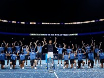 LONDON, ENGLAND - NOVEMBER 22:  Daniil Medvedev of Russia poses with the trophy and ball kids after winning his singles final match against Dominic Thiem of Austria during day eight of the Nitto ATP World Tour Finals at The O2 Arena on November 22, 2020 in London, England. (Photo by Clive Brunskill/Getty Images)