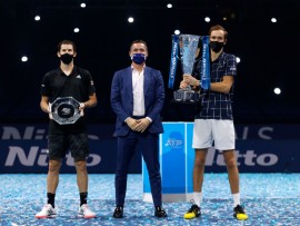 LONDON, ENGLAND - NOVEMBER 22:  Daniil Medvedev of Russia poses with the winners trophy and Dominic Thiem of Austria poses with runners up plate with Andrea Gaudenzi, Chairman of the ATP after their singles final match during day eight of the Nitto ATP World Tour Finals at The O2 Arena on November 22, 2020 in London, England. (Photo by Clive Brunskill/Getty Images)