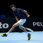 LONDON, ENGLAND - NOVEMBER 20: Daniil Medvedev of Russia serves plays a 'tweener' through the legs shot during his singles match against Diego Schwartzman of Argentina during day six of the Nitto ATP World Tour Finals at The O2 Arena on November 20, 2020 in London, England. (Photo by Clive Brunskill/Getty Images)
